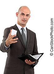 Businessman holding out his business card