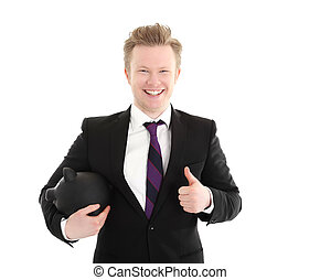 Businessman holding piggybank