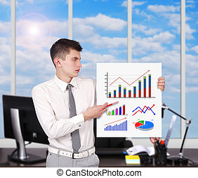 businessman holding placard with charts