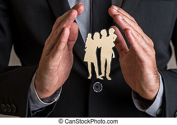 Businessman holding protective or healing hands gesture around a silhouette of a family