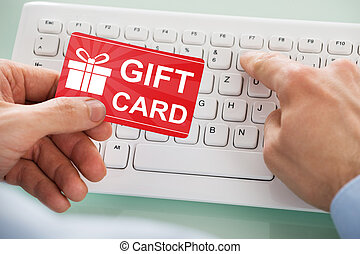 Businessman Holding Red Gift Card