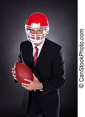 Businessman Holding Rugby Ball
