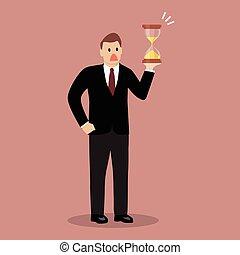 Businessman holding sandglass