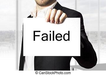 businessman holding sign failed