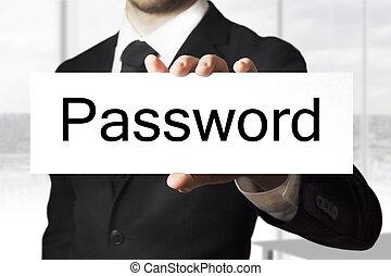 businessman holding sign password