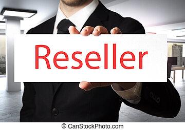 businessman holding sign reseller