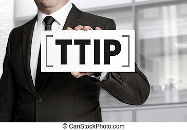 Businessman holding sign TTIP to viewer
