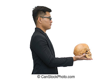 Businessman holding skull isolated on white background with clipping path