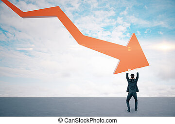 Businessman holding stock crash red arrow on cloud background.