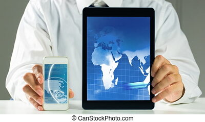 Businessman holding Tablet and Phone video
