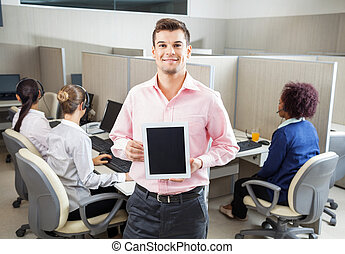 Businessman Holding Tablet Computer In Call Center