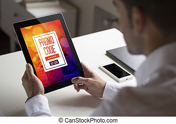 businessman holding tablet pc with promo code