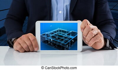 Businessman holding tablet showing construction video