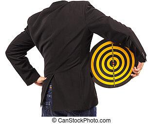 businessman holding target behind