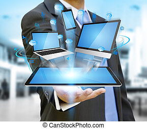Businessman holding tech device in his hand - Businessman ...
