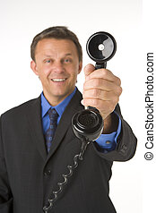 Businessman Holding Telephone
