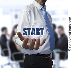 Businessman holding the word start