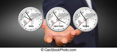 Businessman holding time of the world in his hand