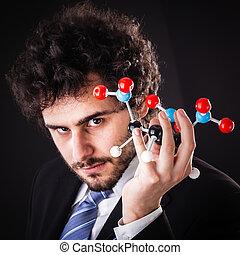 businessman holding tnt atomic structure