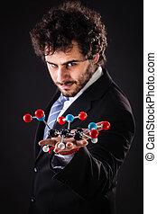 businessman holding tnt molecular structure
