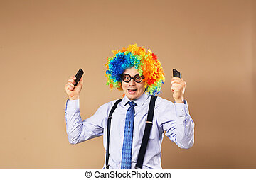 Businessman holding two mobile phones.