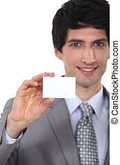 Businessman holding up a blank business card