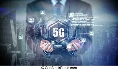 Businessman holding up digital globe showing connection