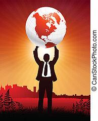 Businessman holding up globe on sunset background