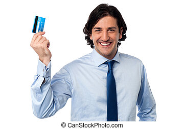 Businessman holding up his credit card