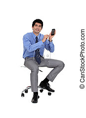 Businessman holding up his mobile phone