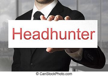 businessman holding white sign headhunter - businessman in...