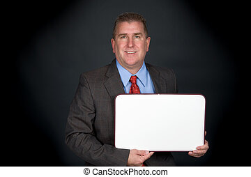 Businessman holding whiteboard