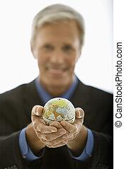 Businessman holding world. - Selective focus of Caucasian...