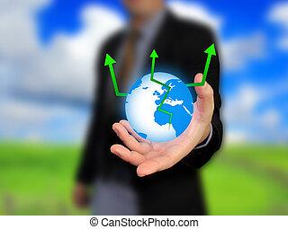 Businessman holding world