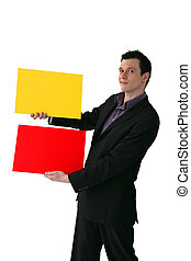 Businessman holding yellow and red rectangles