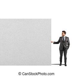 Businessman holds a blank billboard