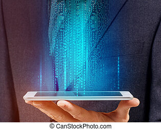 Businessman holds digital tablet with glowing computer code.