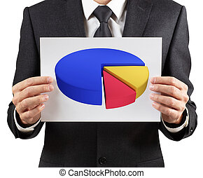 Businessman holds printout with colorful pie graph.