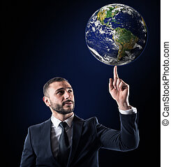 Businessman holds the world with a finger. World provided by NASA