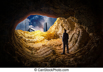 Businessman in a cave, business success search