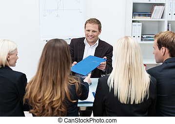 Businessman in a corporate interview handing over his...