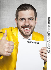businessman in a gold suit and thumbs up, the new agreement