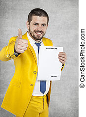 businessman in a gold suit showing thumbs up, the new agreement