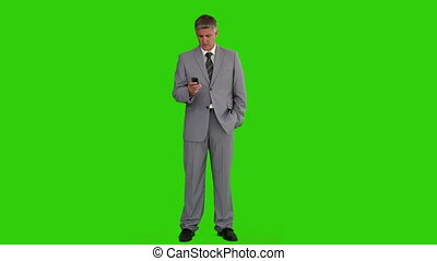 Businessman in a gray suit holding a remote control
