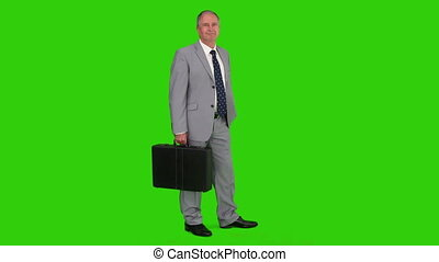 Businessman in  a gray suit with a briefcase