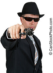 businessman in a hat and sunglasses with a gun