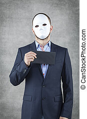 Businessman in a mask with a bribe