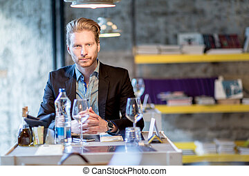 Businessman in a restaurant sitting at the table