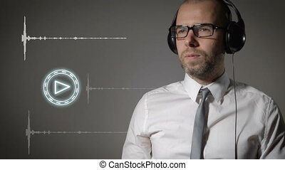 Businessman in a shirt and big headphones, click on the play button and start listening to music.