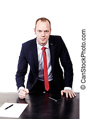 Businessman in a suit corrects